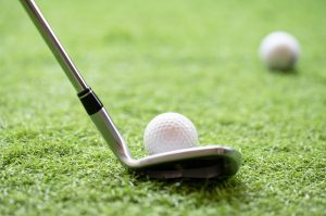Selective,Golf,Club,And,Golf,Ball,On,Green,Grass,Background.iron